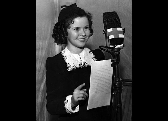 June 22, 1940: Actress Shirley Temple appears at a two-hour nationwide radio benefit for the American Red Cross Mercy Fund. More than 50 celebrities, including Bing Crosby and Mickey Rooney, helped raise hundreds of thousands of dollars to help war refugees in Europe.