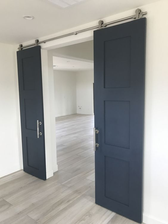 Double Shaker style barn doors painted navy blue.