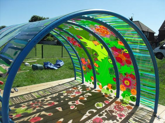 """Outdoor """"Den"""" I would leave it clear for the children to paint on.  Basically becomes colour/light play."""