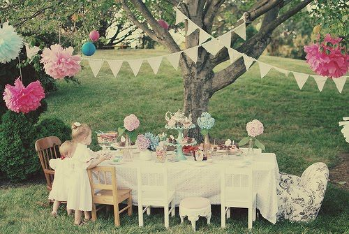 Hanging decorations, bunting and with a scaled tea party to suit the company! Adorable