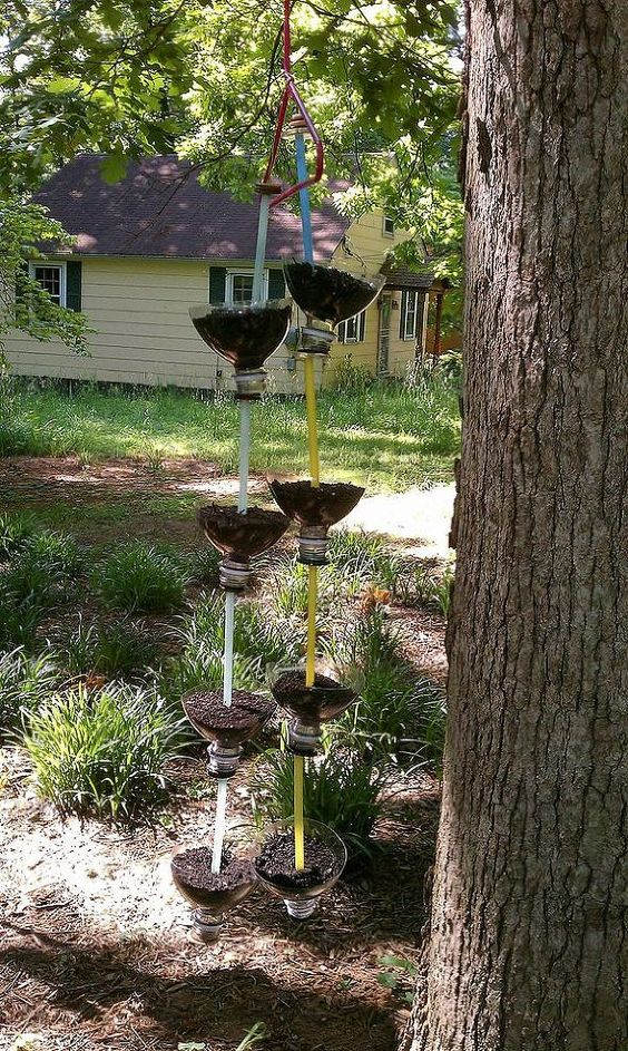 Here is the 4 bottle chain filled with dirt and seeds. Now all I have to do is water and wait.