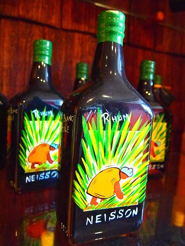 Brightly colored, hand-painted bottles for sale at the Rhum Neisson Distillery.