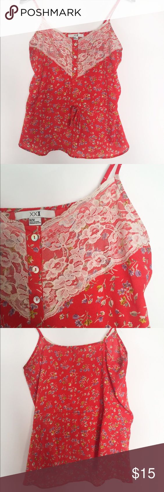 """Forever 21 Floral Lace Tank M In good pre-owned condition. Slight discolor under armpits see picture 4. Cute formal top with lace detail near the neckline. Adjustable straps and draw string around waist. Measurements are 25"""" long and 22"""" pit-pit. 100% polyester. Forever 21 Tops Tank Tops"""