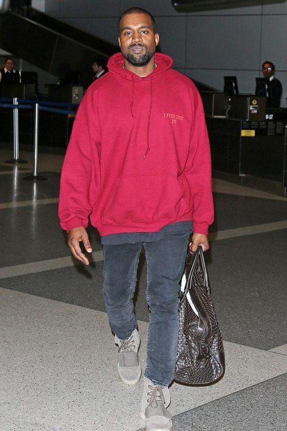 Kanye West wearing  Acne Ace Used Cash Jeans, Fan Merchandise Yeezy Season 3 Concert I Feel Like Pablo Hoodie, Adidas Yeezy Boost  750, Bottega Veneta Ebano Intrecciato VN Large Duffel