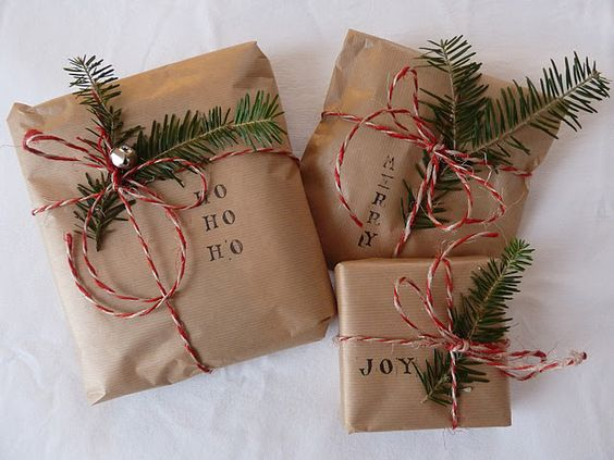 simple Christmas gift wrap: brown paper, stamps, evergreen, bakery twine: