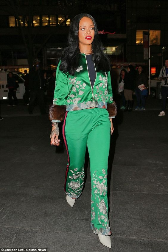 Blooming lovely: The 28-year-old singer's silky tracksuit featured a floral embroidered detailing