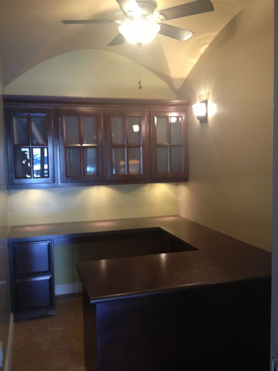 Office addition, complete with custom cabinets, laminate counter tops, tiled floors, ceiling fan, scones lights, under cabinet lights, groin vault ceilings.