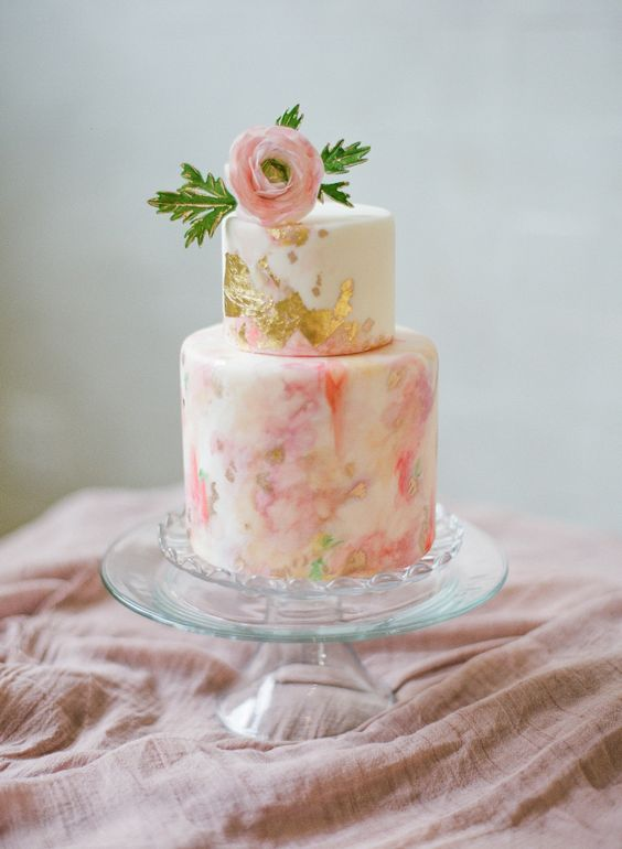 Pink and gilded watercolor wedding cake: http://www.stylemepretty.com/louisiana-weddings/new-orleans/2015/11/12/elegant-feminine-wedding-inspiration-at-il-mercato/ | Photography: Catherine Guidry - http://catherineguidry.com/