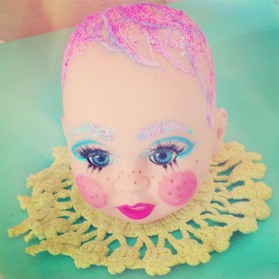 I made one of my doll heads into a drag queen clown baby.