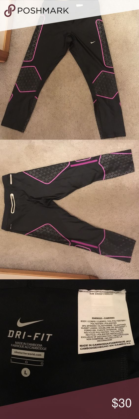 Nike Dri-Fit Capri Leggings Large Never worn black with gray and fascia, has a pocket in back for phone, etc. Perfect condition Nike Pants Leggings