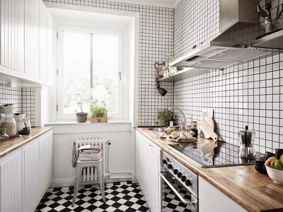 A serene home in neutrals and dusty hues / My Scandinavian Home / Love this cute, bright kitchen! The butcher block counter top is gorgeous, and love the checkered flooring!:
