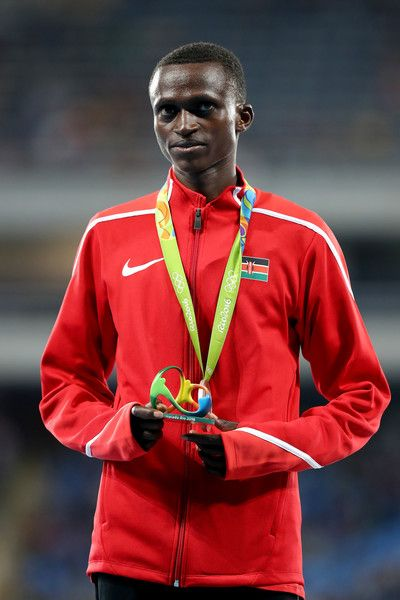 Silver medalist Paul Kipngetich Tanui of Kenya celebrates on the podium during the medal ceremony for the Men's 10,000m on Day 8 of the Rio 2016 Olympic Games at the Olympic Stadium on August 13, 2016 in Rio de Janeiro, Brazil.