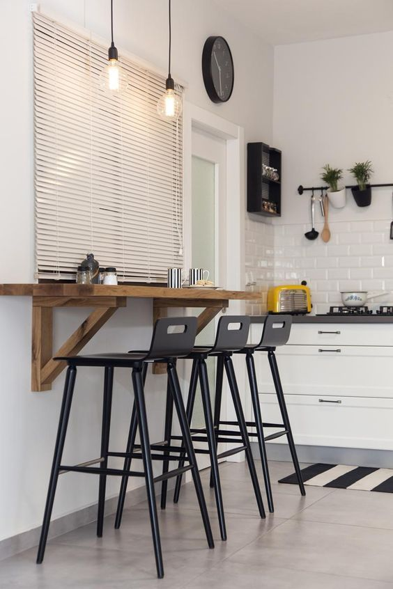 A Modern Industrial Breakfast Bar With A Wall Mounted Tabletop