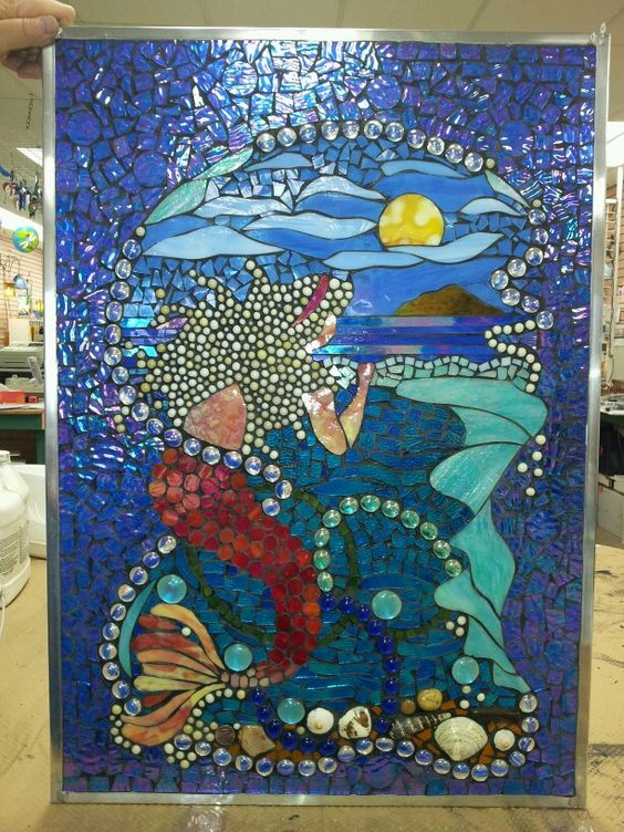 A beautiful mosaic Mermaid longing to live on land