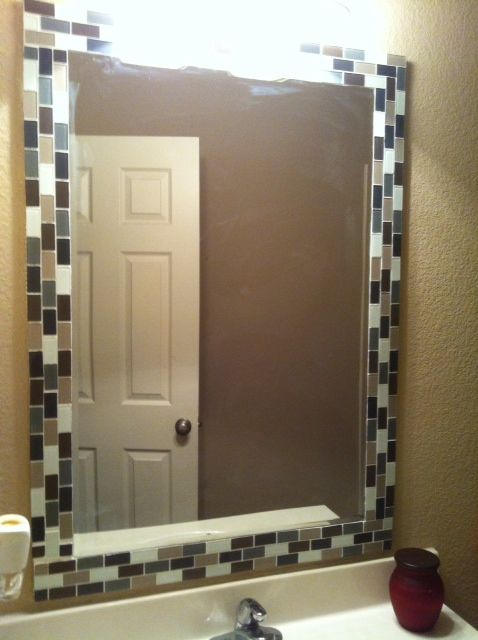 DIY bathroom mirror: Cut a piece of thin plywood, paint sides so you don't see it from the side, glue plain mirror from Lowe's ($20), screw to studs. Cut sq sheets of tile into strips of 3. Apply with adhesive/grout (this hides screws). Dry overnight. Finish by grouting. Less than $40!