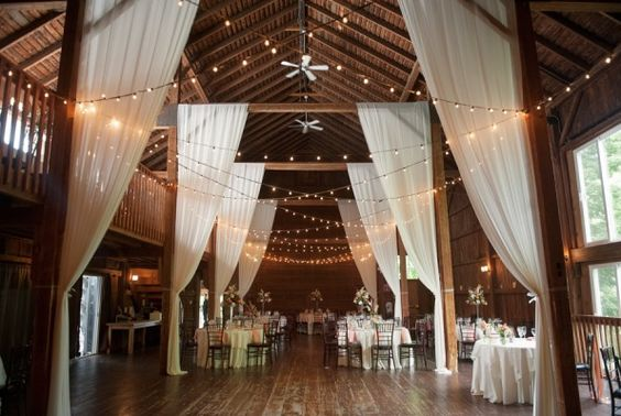 INPSIRATION: We love how the cross design of the festoons works with the faux curtains on each beam