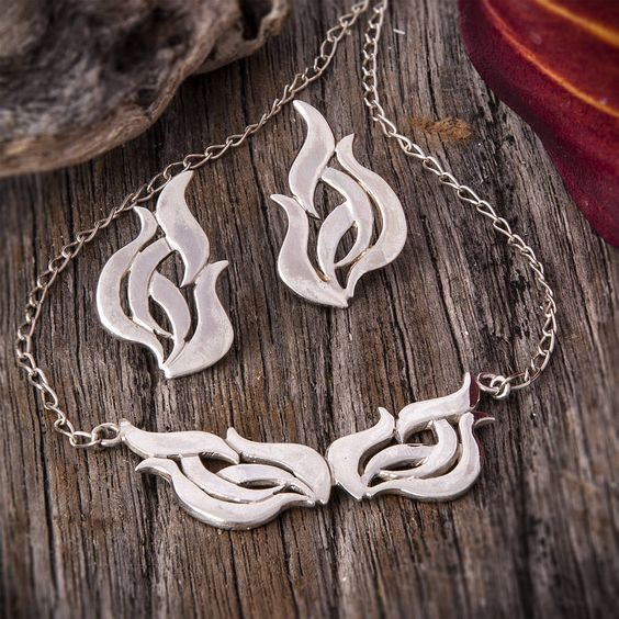 silver flame necklace by charlotte cornelius jewellery design | notonthehighstreet.com