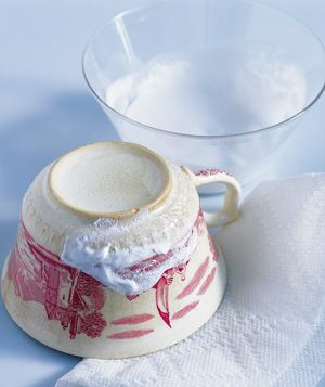 Clean discolored teacups and teapots by making a paste of baking soda and water. Gently rub over the stain to remove.