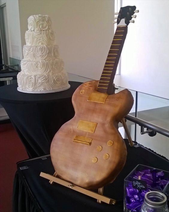 Grooms cake on dessert table. Upright guitar cake.