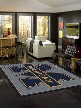 """Amazon.com: Michigan Wolverines 5' 4"""" x 7' 8"""" Team Spirit Area Rug: Home & Kitchen"""