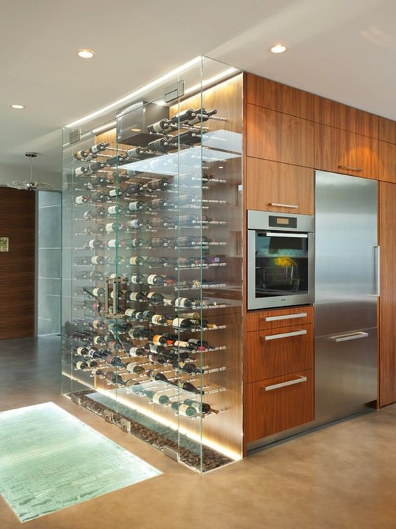 Sleek & modern kitchen design with built-in wine bottle display. Love this idea and that super cool floor