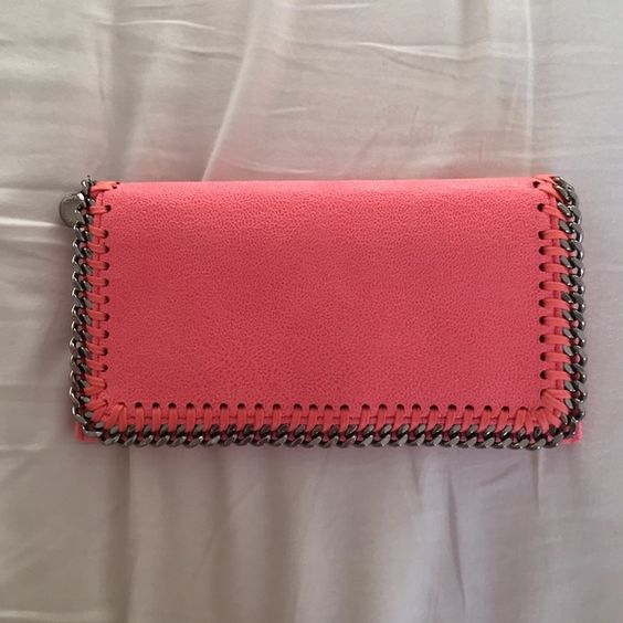 NWOT Stella McCartney Falabella Wallet Never used, perfect condition. Was the last in this color, so it might have been the display item hence the small number on the inside of the zipper. I am not in a rush to sell this, I love this wallet, so no lowball offers or trades. Thanks! Stella McCartney Bags Wallets