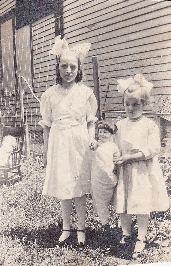 Sisters with their doll