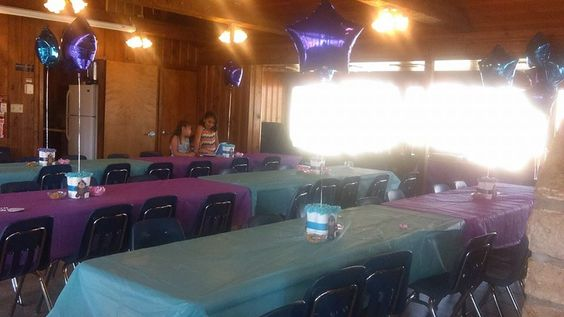 How i decorated the hall for the baby girl monkey themed shower. purple and teal table clothes. monkey diaper cake center pieces with balloons coming out of middle
