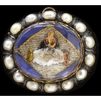 ca. 1700-1725 (made). Enamelled gold, with silver, set with pearls and with hair under glass. The symbolic representations of love used in this jewel - clasped hands and a heart aflame - were widely used and understood in the 17th century.   The slide was a very popular type of jewel at this date. Fitted with two flat loops at the back, a ribbon of silk or woven hair would be threaded through enabling it to be worn around the neck or wrist.