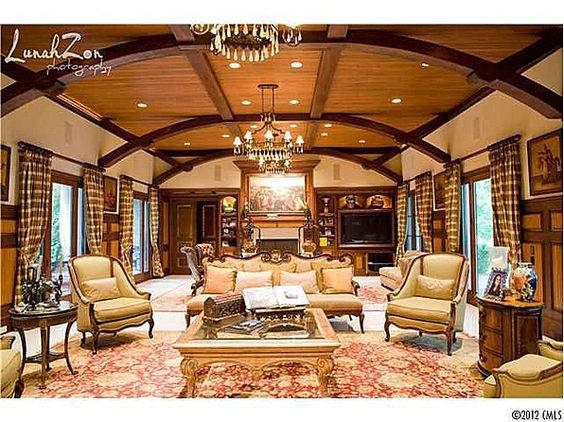 love the curved beams in the ceiling..... I'd toss everything else in this room straight in the dumpster, though!