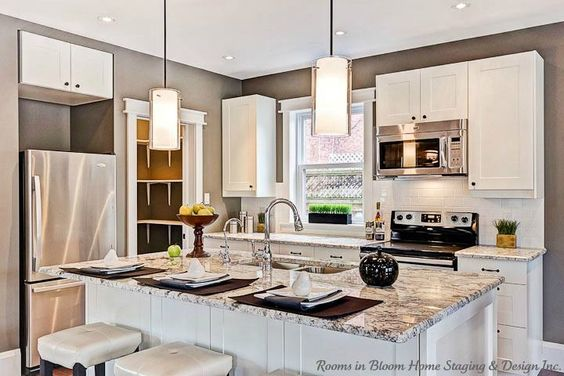 Beautifully restored guelph home staged sold islands for Update white kitchen cabinets