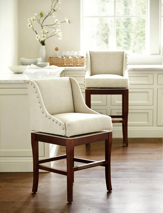 This Marcello Counter Stool 39 S Sloping Padded Arms Offer The Wraparound C