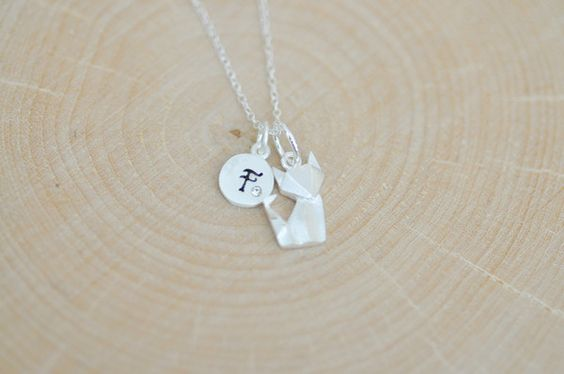 What does the Fox Say? Super super adorable cute little Origami Fox Necklace! You won't be disappointed...love love this piece. This little fox is finished in M