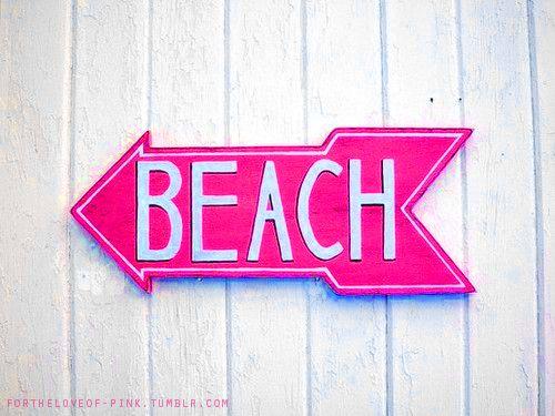 neon pink beach sign
