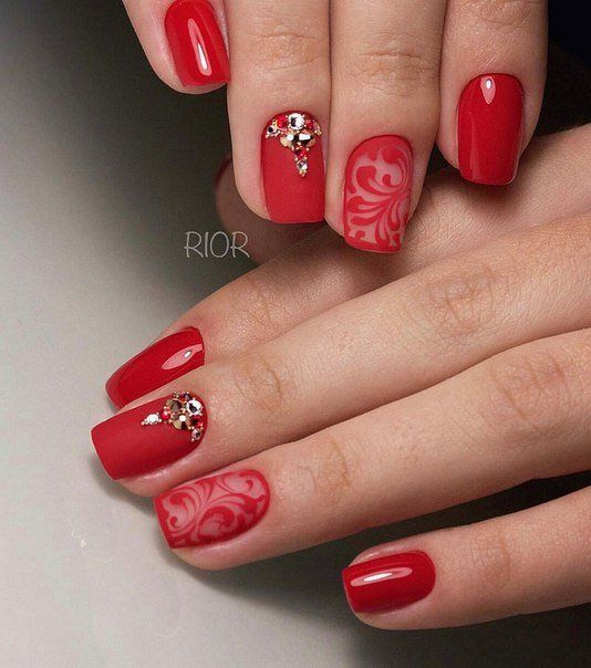 A luxury manicure, which is based on a beautiful combination of matte stamp and glossy coating with a picture. More nails are painted by bright scarlet col: