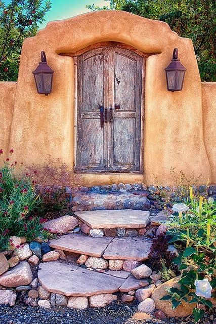 Santa Fe, New Mexico; love the doorway but the rock and slate stairs would look great in my garden!