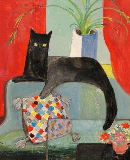 Gato negro en almohadones