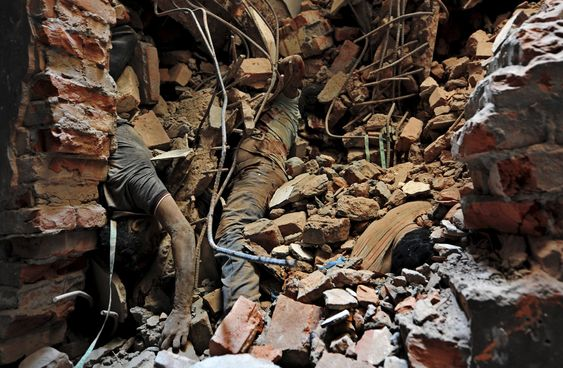 9/11, Bodies of garment workers lie among the rubble of the collapsed Rana. September 11, 2001. Heroes, remember, never forget, terrorist attack, horrible.