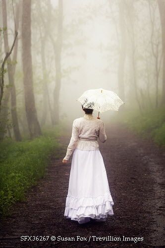 Trevillion Images - woman-with-parasol-in-fog