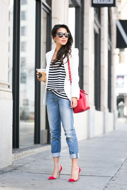 Dress up your distressed boyfriend jeans with a white blazer and red pumps. Swipe on a red lip to pull the entire look together.