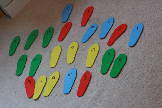 """""""Stomp it"""" game. Trace child's foot on colored foam and write letter and/or sound blends. When you calll out the sound, have child stomp on the correct 'foot'."""