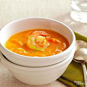 To tailor the spiciness of this smooth and silky soup, start with 2 tablespoons of the red curry paste, taste, and add more if desired. To make this soup vegetarian, skip the shrimp and use vegetable broth. /