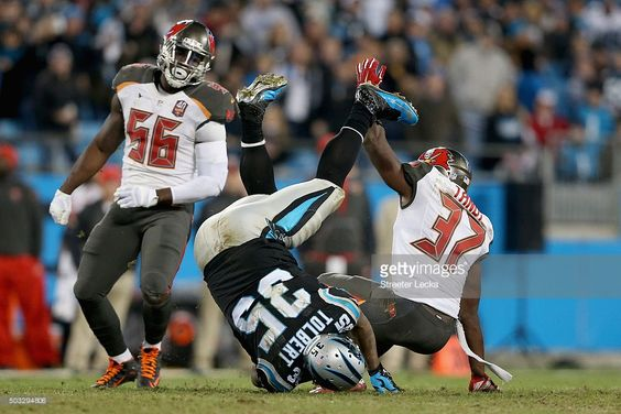tandy newton | Keith Tandy #37 of the Tampa Bay Buccaneers tackles Mike Tolbert…