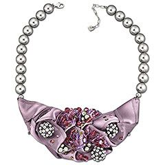 Vintage, romantic opulence. Showing an exceptionally high standard of craftsmanship, this statement necklace is a real eye-catcher. It features a lilac satin ribbon centerpiece delicately embroidered with grey crystal pearls and crystal beading in fresh, feminine colors.