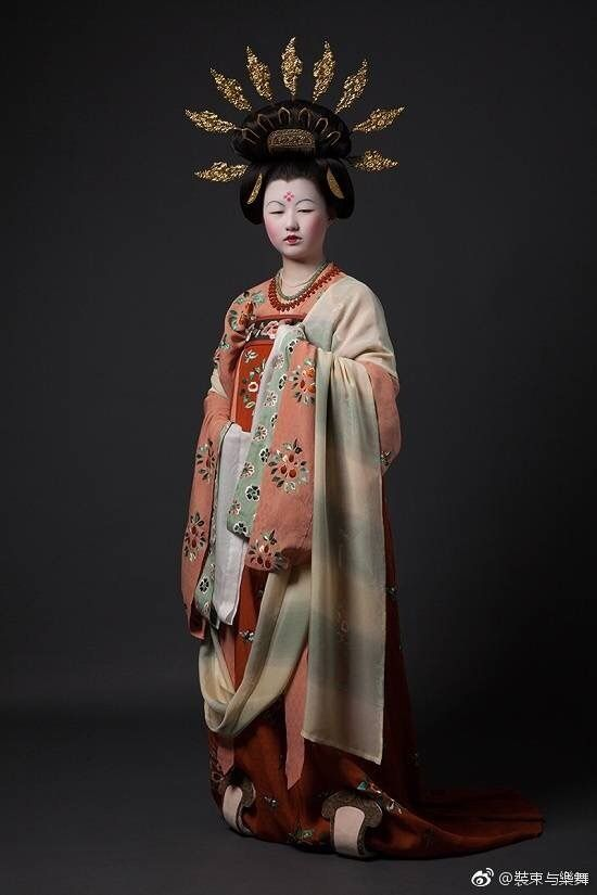 The Chinese Historical Costume Restoration Team's recreation of a Dunhuang portrait, likely from Mogao Cave 9.