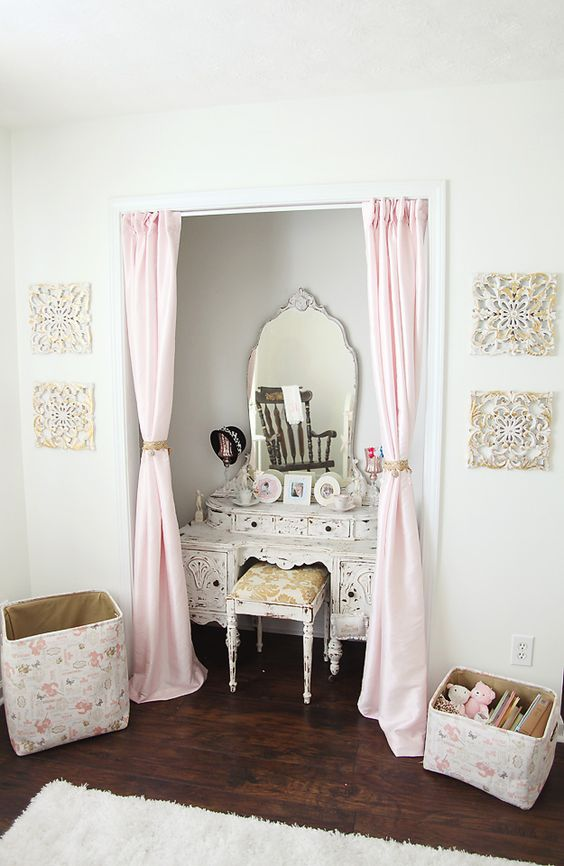 We adore the soft curtains instead of closet doors and a vintage vanity in the closet! Perfect to grow into. #nursery