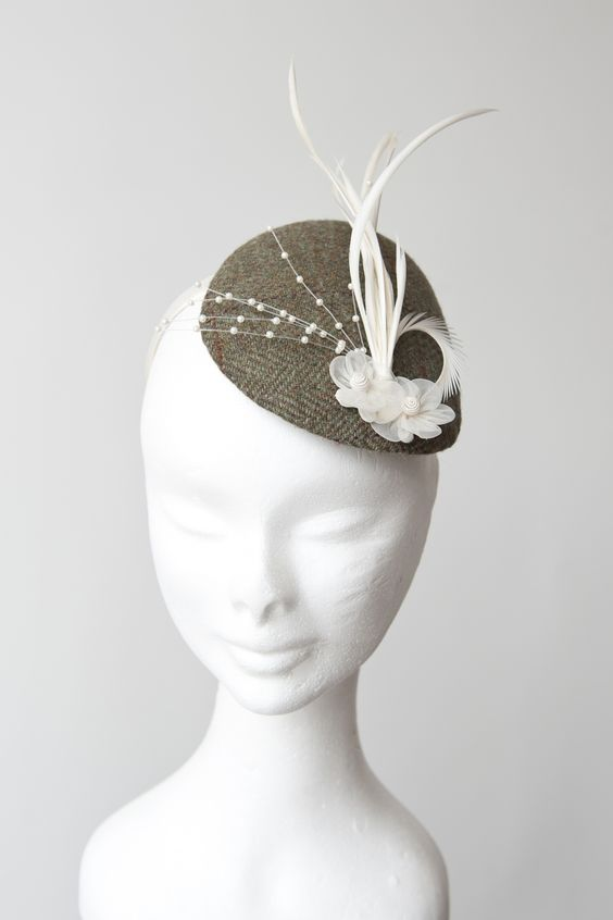 Green tweed fascinator with cream feathers and pearls
