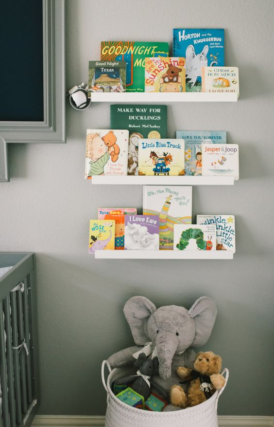 Simple Library Wall with IKEA Picture Ledges - makes for a clean design in the nursery!