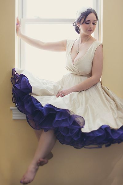 A purple petticoat takes this ivory dress up a notch.:
