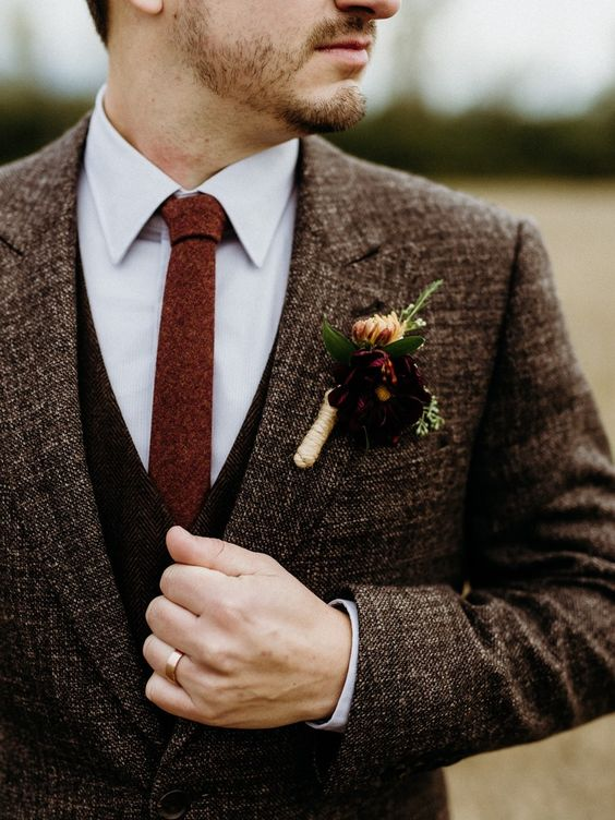Fall boutonniere wrapped in twine.